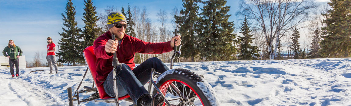 A UAF mechanical engineering student test drives a ski bike