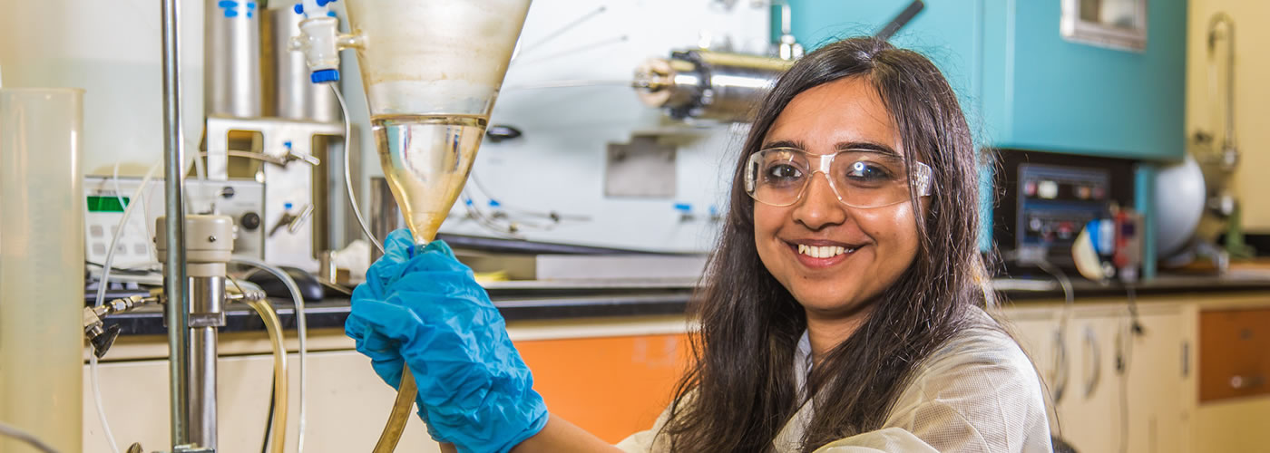 Graduate student Shruti Oza sets up apparatus for a procedure in UAF's Petroleum Development Lab in the Duckering Building.