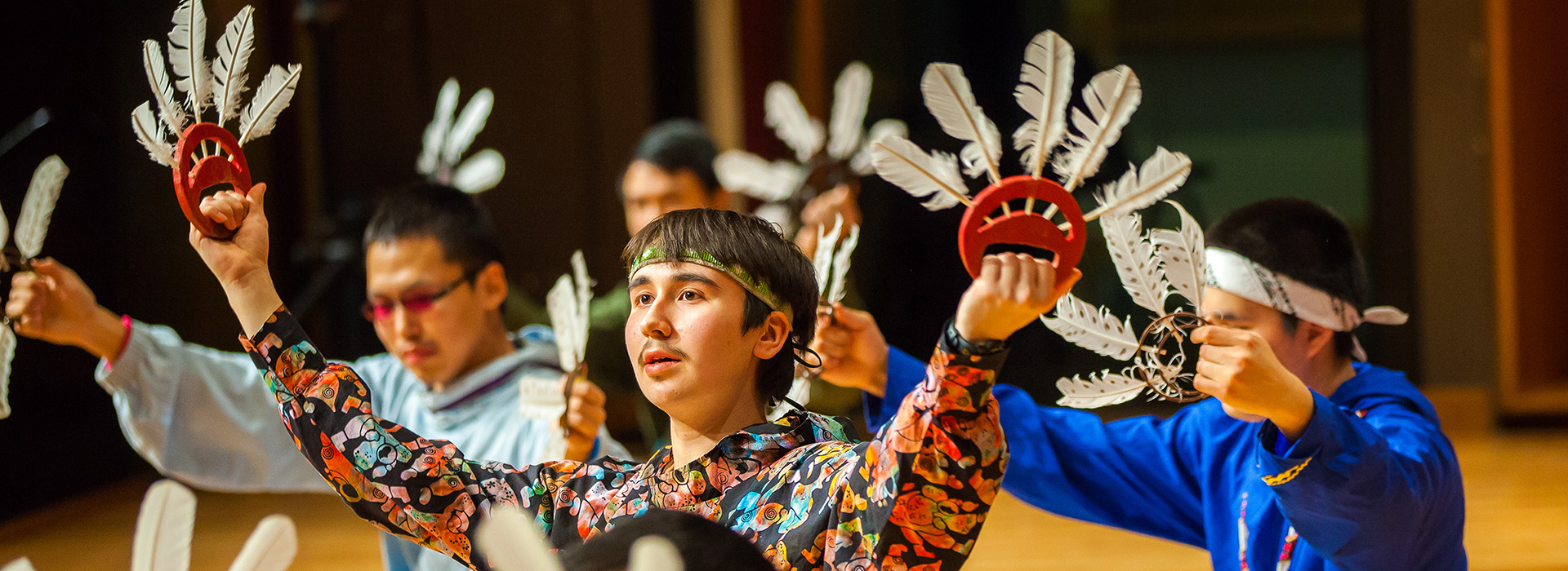 Mechanical Engineering Major, Baxter Bond, performs with the Inu-Yupiaq dance group during the 2013 Festival of Native Arts. Credit: UAF Photo by JR Ancheta
