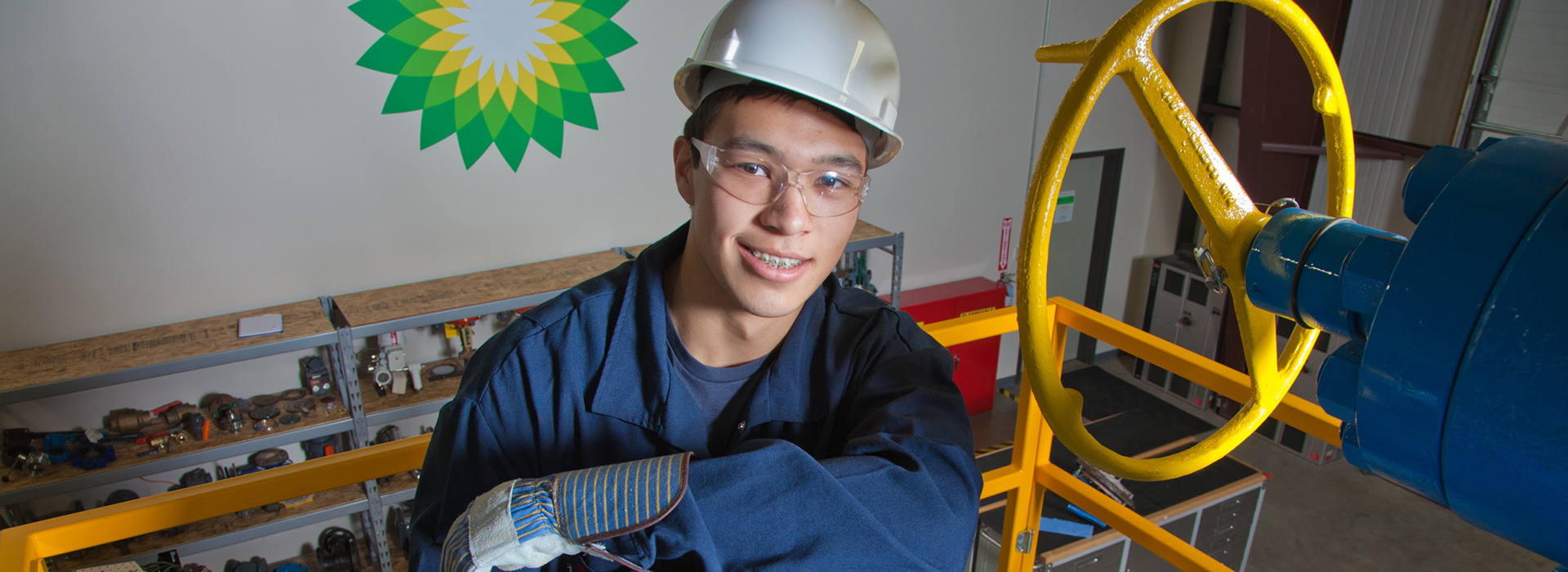 Petroleum Engineering and Process Technology major, Stefan Weingarth, opens a valve on the oil field well head at CTC's process technology facility on Van Horn Road. The working well head was part of a donation worth almost $4 million made by BP. Credit: UAF Photo by Todd Paris