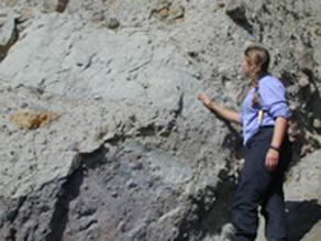 Patricia Heiser pointing to silt bodies within the lahar deposit