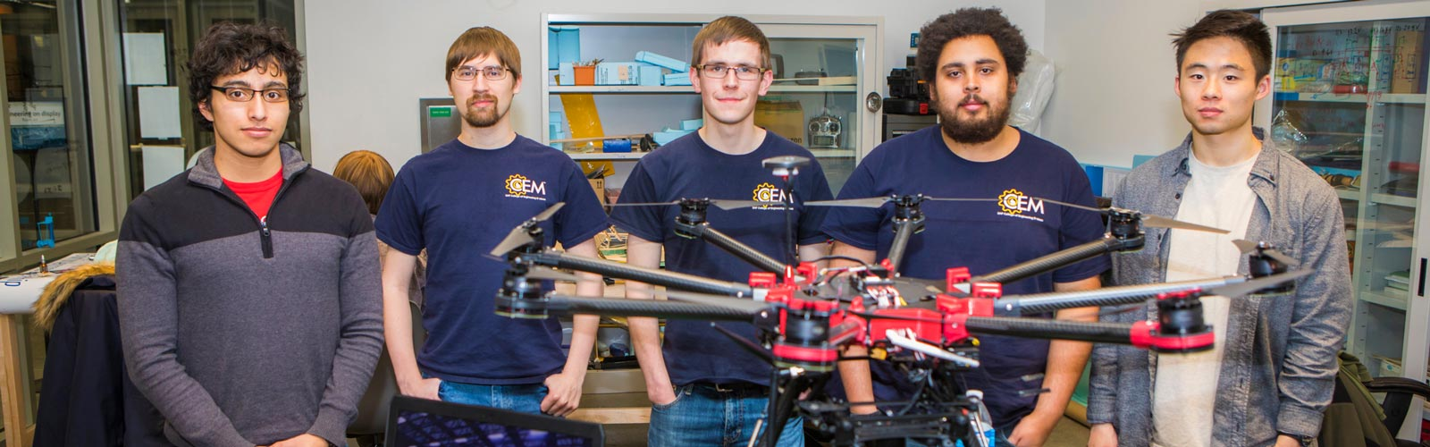 Students posing with their drone