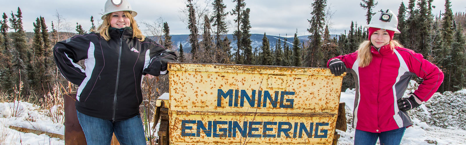 Students posing in front of miningb engineering sign