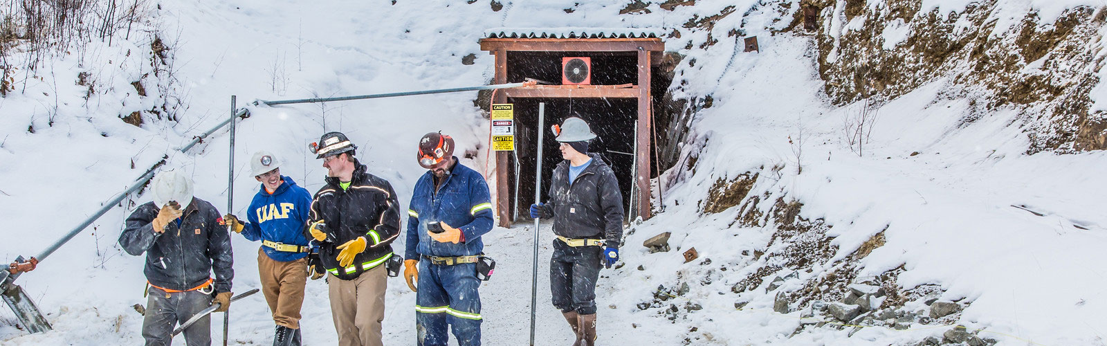 People exiting Silver Fox mine.