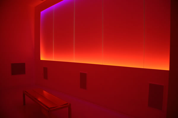 The Place Where You Go to Listen illuminated in red light