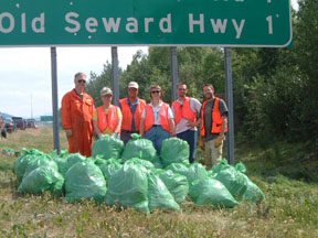 CNIPM members pull invasive plants along Seward Highway.