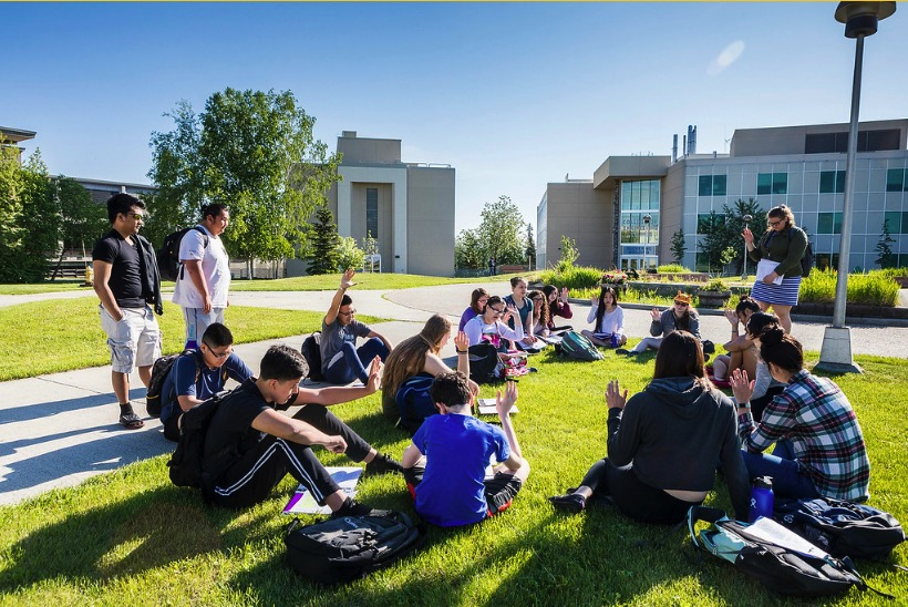 Students enjoy a summer class held outside in Cornerstone Plaza on the Fairbanks campus
