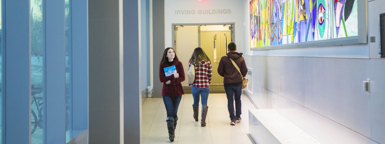 UAF students walk through the corridor connecting the Murie and Irving buildings on the Fairbanks campus.
