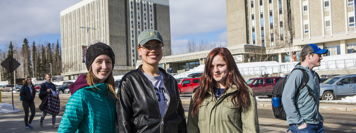 UAF student ambassadors outside the MBS residence hall complex