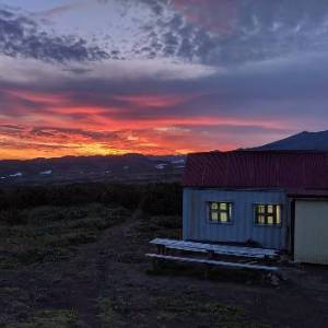 Sunset at Mutnovsky Volcano in Kamchatka. View form our basecamp at Vakin Hut