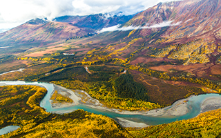 Boreal forest mountain ridge and river valley somewhere north of Fairbanks in early September.