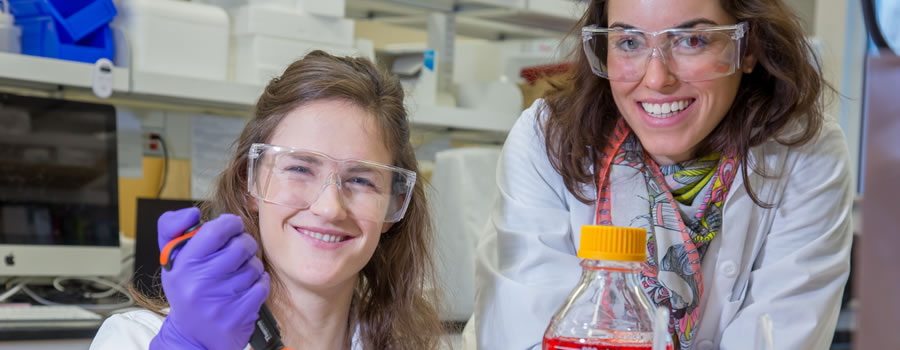 two female UAF students in a lab