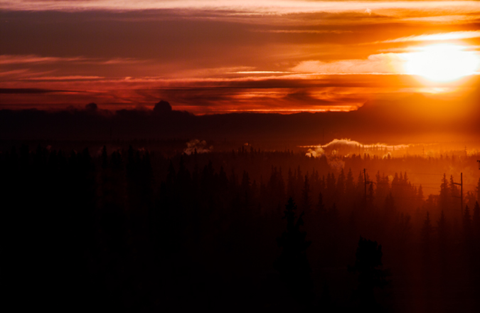 The sun rises over the Alaska range.