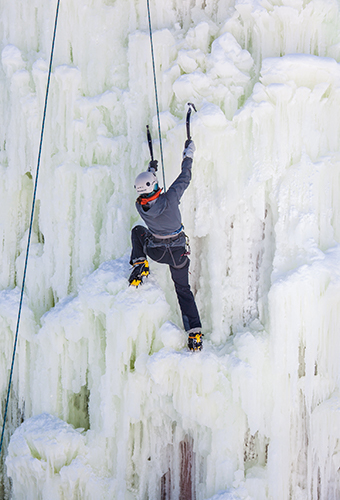 Student climbing ice wall