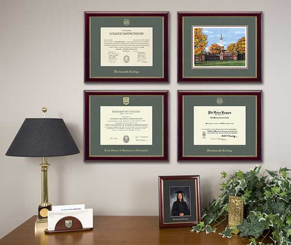 Framed diplomas displayed on an office wall