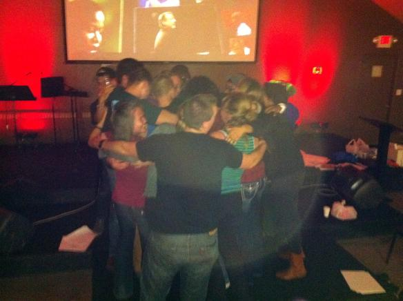 Passion seminar group hug lead by Kristine DeLeon