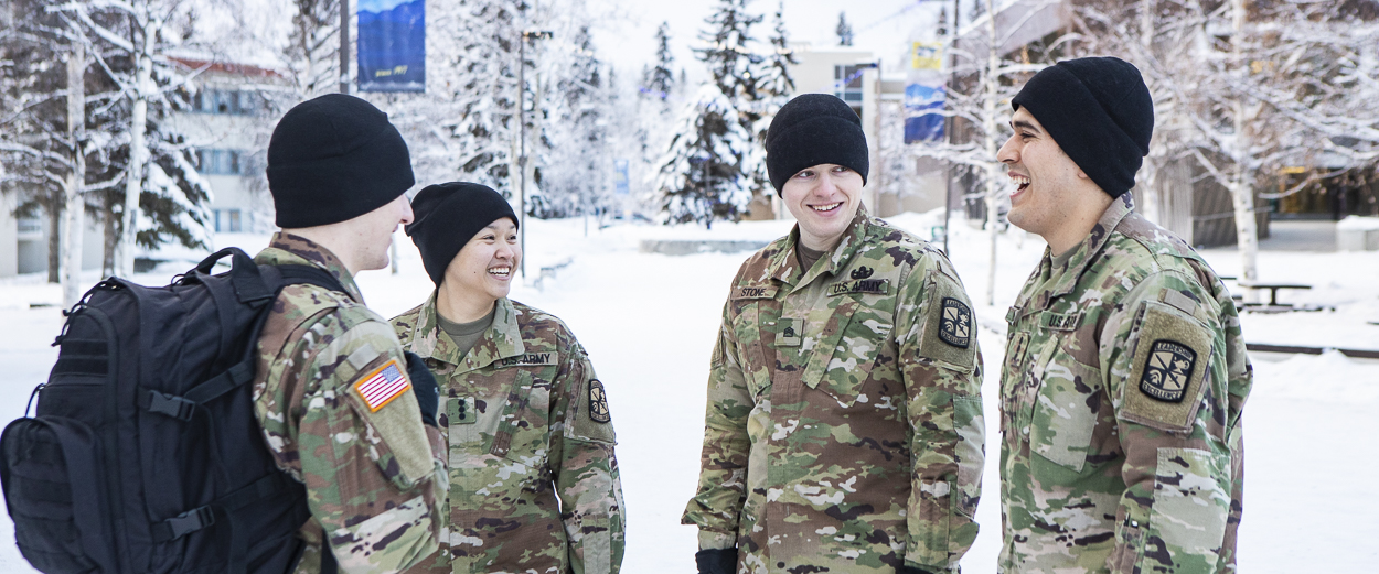 UAF ROTC students gather outside UAF Wood Center during the winter
