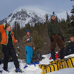 UAF grad take a break from stomping out a 1-kilometer snowshoe line across the Denali Fault near Cantwell