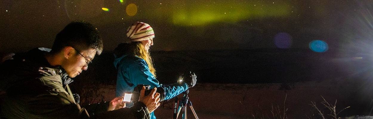 A pair UAF students photographing the Aurora