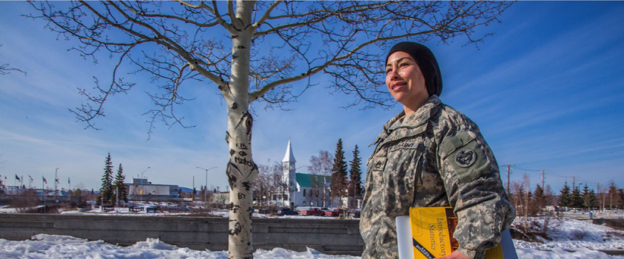 Ft Wainwright student walking through Fairbanks Golden Heart Park